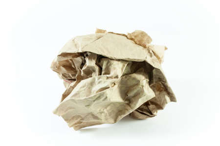 Crumpled ball brown paper on isolated with white background.