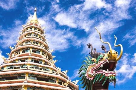 pla: Pagoda Statue Dragon Head Statue At Wat Huai Pla Kang With Blue Sky Background.