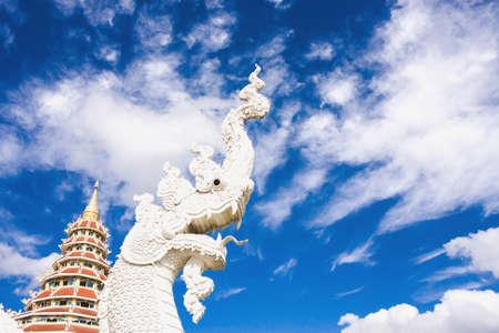 pla: Chiang Rai Province Thailand - January 01, 2016: Naga Head Statue At Wat Huai Pla Kang With Blue Sky Background.