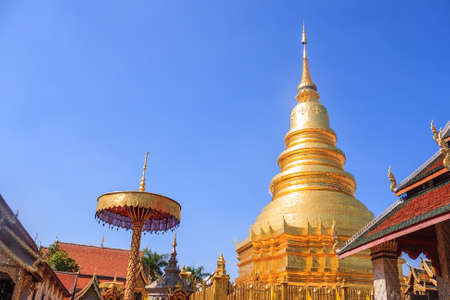 hariphunchai: Lamphun, Thailand - December 10, 2014: Ancient Pagoda Statue Of Wat Phra That Hariphunchai With Blue Sky Background. Stock Photo