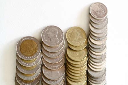 slump: Baht Thai Coins Stacked Isolated On White Background. Stock Photo