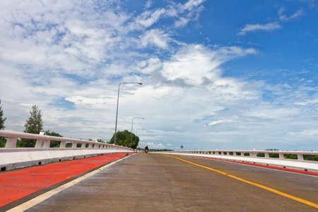 bike lane: Empty Street And Bike Lane At Blue Sky Background. Stock Photo