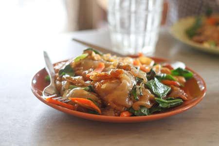 Stir Fried Fresh Rice Flour Noodles In Black Soy Sauce.