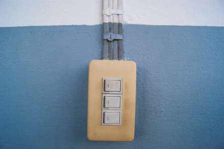 switches: Electric switches fanang cement vintage Stock Photo