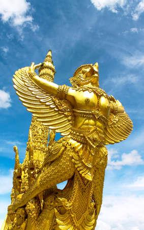 garuda: a statue of a golden garuda images in ubon