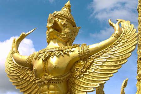 isaan: a statue of a golden garuda a bird in ubon