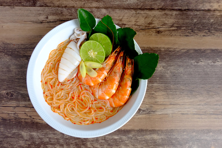 Seafood vietnamese noodle soup on wood background