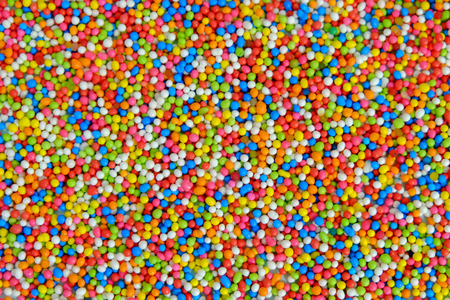 Rainbow sprinkle sugar background, Multicolor sugar texture wallpaper, Sugar for cake decorate Banque d'images - 122393532