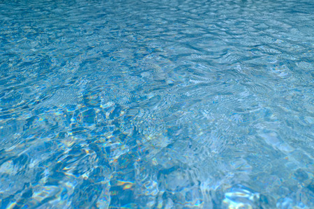 Blue water ripple reflection in the swimming pool background, Reflection on the water surface, Water in the pool Banque d'images - 122393541