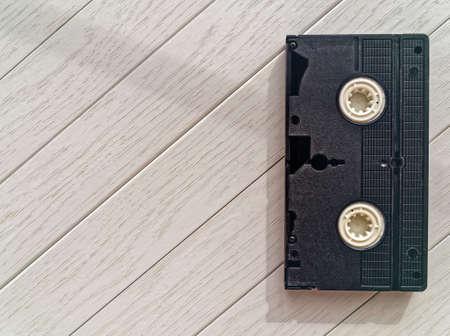 videocassette: Video cassette on a light wooden background