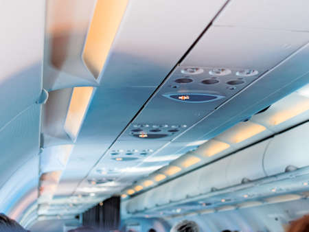 The sign do not smoke in the cabin of the plane in economy class. Smoking ban on flights