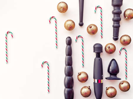 sex toys golden christmas balls and candies new year or christmas festive background stock - Christmas Sex Toys