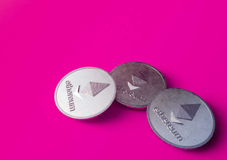 Three coins of the Ethereum crypto currency are on a purple background. 3D rendering