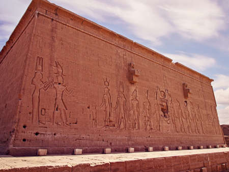 Temple of Hathor, located in the town of Dendera. One of the buildings of the complex. Ancient Egyptian symbols, images of kings, gods and pharaohs are hollowed out.