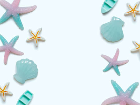 Creative travel background. Layout of various sea figures (starfish, boats, shells). Preparing for vacation and travel. Flat lay. Copy space.