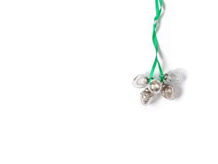 A bunch of Christmas glass balls tied with green ribbon and isolated on  white