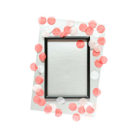 Abstract template in a minimalistic style. An empty black photo frame and a sheet of silvery paper will be on a white background. The mockup is decorated with round confetti. Flat lay. Copy space. Stock fotó