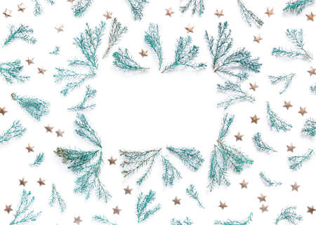 Festive frame made of thuja branches and golden stars on a white background. Template for New Year and Christmas cards, birthday greetings, banner. Flat lat, top view, copy space. Stock fotó