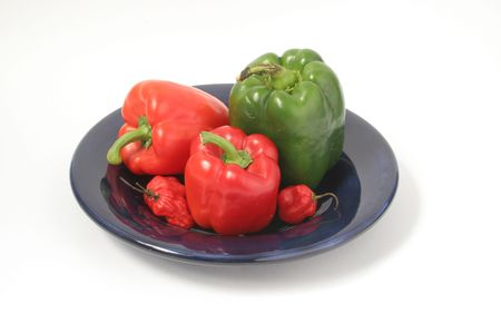 assorted peppers on blue plate