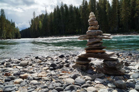 wells: Pile of Stones at the bank of a river in Wells Gray PP Stock Photo