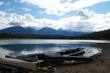 jasper: Canoes at the edge of a lake in Jasper NP Stock Photo