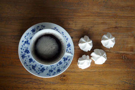 delft: Delft blue cup of coffee with foam cookies Stock Photo