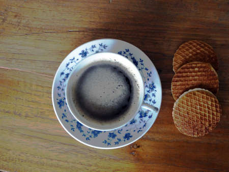 treacle: Delft blue cup of coffee with cookies