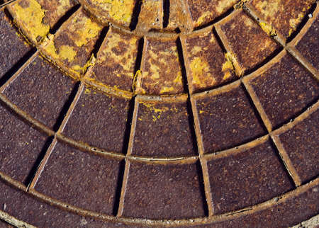 rusty background: Old dirty rusty sewer manhole rough surface texture background