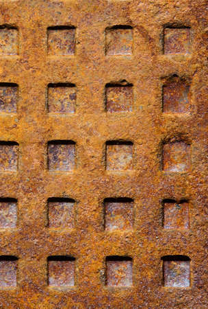 Old dirty rusty sewer manhole rough surface texture background with square pattern photo