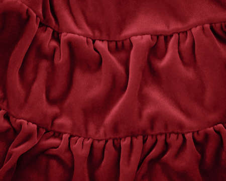 fleece fabric: Closeup macro texture of modern red crimson burgundy marsala color fleece fabric, clothing background with wrinkles and folds, luxury royal trendy concept, pantone color of 2015 year