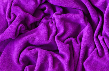 fleece fabric: Closeup macro texture of pink violet purple fleece fabric, clothing background with wrinkles and folds