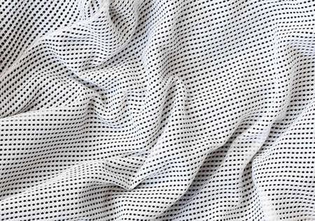 Textura macro Primer plano de nylon perforado tela de algodón, ropa de fondo con las arrugas y pliegues