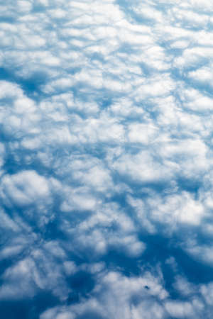 Light blue sky with small white clouds, view from above Stock Photo - 36806118
