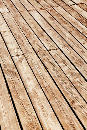 Closeup of wooden planks of fence, boardwalk, texture background. Vertical diagonal lines