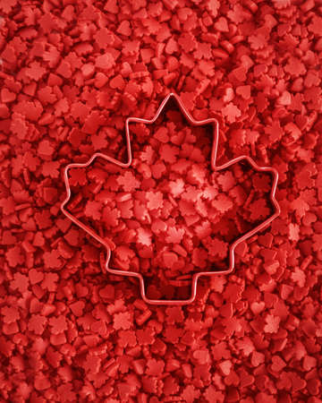 leaf cutter: Vibrant red colorful small tiny candies maple leafs and hearts, cookie cutter with the shape of maple leaf in the center, view from above, Canada Day celebrate concept