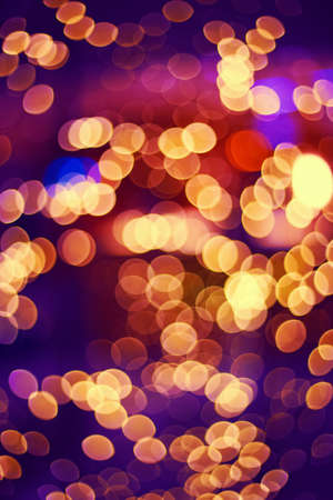cinematic: Abstract colorful blurry background bokeh, cold and warm colors tone, pink, violet, pirple, yellow, red colors, cinematic effect, evening night street romantic lights