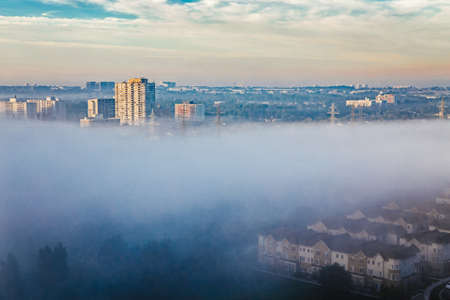 Foggy morning in Toronto city, Canada. Rays of early rising sun.