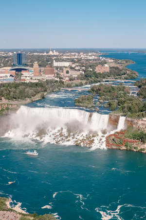 Aerial top landscape view of Niagara Falls between United States of America and Canada. View on America state New York from Canadian waterfall. Water tour boat at famous tourist landmark Stock Photo