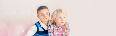Happy Caucasian funny children together. Best friends forever. Valentine Day holiday concept. Web banner header for website. Boy and girl having fun hugging. Love and friendship.