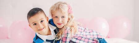 Happy Caucasian funny children hugging. Best friends forever. Valentine Day holiday concept. Web banner header for website. Boy and girl having fun. Love and friendship. Reklamní fotografie