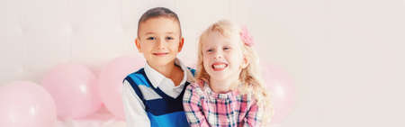 Happy Caucasian funny children laughing hugging. Best friends forever. Valentine Day holiday concept. Web banner header for website. Boy and girl having fun together. Love and friendship.
