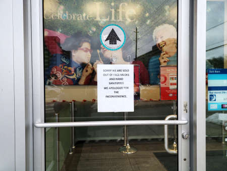 Toronto, Ontario, Canada - January 27, 2020: Notice announcement on Shoppers Drug Mart entrance door. Hand sanitizer and face masks are sold out in Toronto pharmacy shop store.