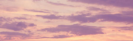 Beautiful colorful pink purple clouds on sky at sunset or sunrise. Evening or morning pastel color sky natural eco background. Amazing nature texture surface wallpaper. Web banner header. Banco de Imagens