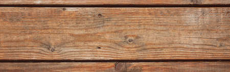 Closeup macro of wooden planks surface. Abstract natural red brown wooden texture background wallpaper. Natural eco wood material backdrop. Web banner header. Banco de Imagens