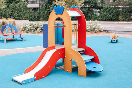 Colorful playground for children outdoor.  Public sport equipment in park for kids, children and babies for physical development.