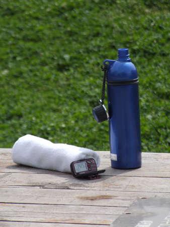 bottle,pedmeter,towel