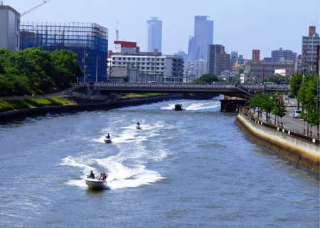 motorboats: motorboats in a river