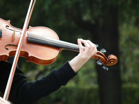 playing violin in woods Stock Photo