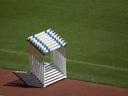 piled hurdles in a field and track events