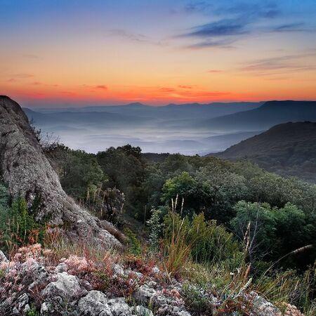 mountains on a  sunrise background Imagens